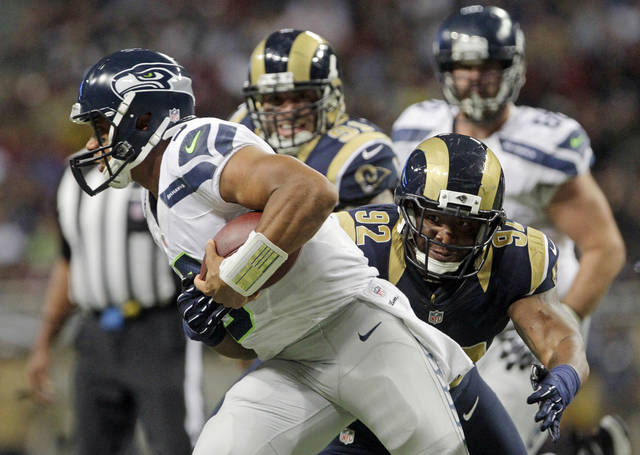 Seattle Seahawks' Russell Wilson (3) is sacked by St. Louis Rams' Eugene Sims (92) during the first half of an NFL football game Sunday, Sept. 30, 2012, in St. Louis. (AP Photo/Seth Perlman)