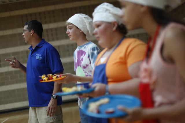 Participants present their dishes during Snack Wars at the YMCA in downtown Oklahoma City, Saturday, June 23, 2012.  Photo by Garett Fisbeck, The Oklahoman