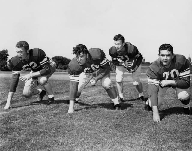 Left to right: Merle Dinkins, Wade Walker, Darrell Royal and Dee Andros. Oklahoman Archive.