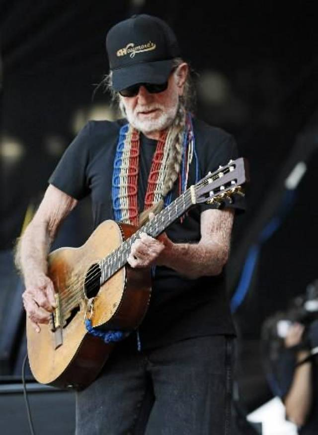 Willie Nelson performs during the Oklahoma Twister Relief Concert, benefiting victims of the May tornadoes, at Gaylord Family - Oklahoma Memorial Stadium on the campus of the University of Oklahoma in Norman, Okla., Saturday, July 6, 2013. Photo by Nate Billings, The Oklahoman
