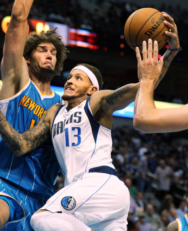 Dallas Mavericks guard Delonte West (13) drives to the basket against New Orleans Hornets center Robin Lopez (15) during their preseason NBA basketball game, Monday, Oct. 22, 2012, in Dallas. The Mavericks won 87-74. (AP Photo/The Dallas Morning News, Kye R. Lee) MANDATORY CREDIT; MAGS OUT; TV OUT; INTERNET OUT; AP MEMBERS ONLY