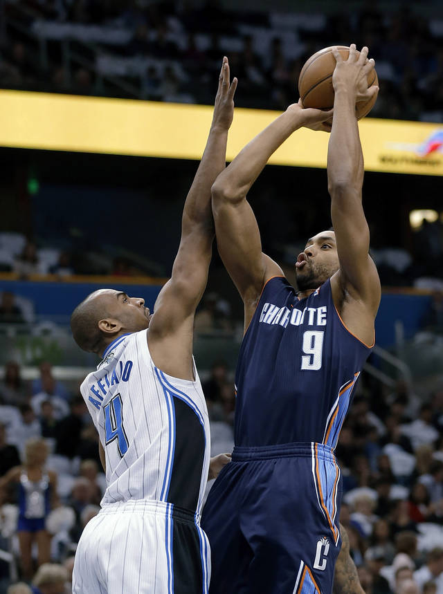 Charlotte Bobcats&#039; Gerald Henderson (9) shoots over Orlando Magic&#039;s Arron Afflalo (4) during the first half of an NBA basketball game Friday, Jan. 18, 2013, in Orlando, Fla. (AP Photo/John Raoux)