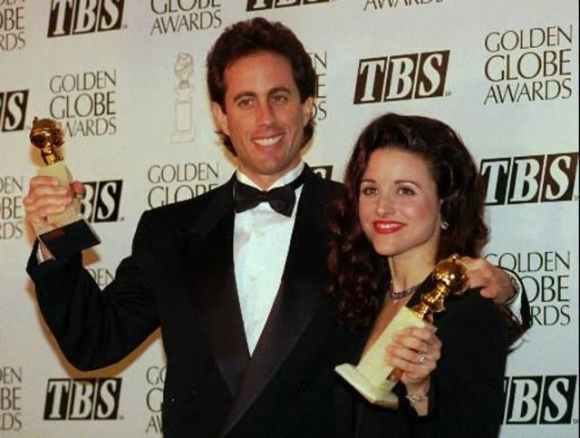 This is a January 1994 photo of Jerry Seinfeld with co-star Julia Louis-Dreyfus at the Golden Globe Awards in Los Angles.(AP Photo/Mark J. Terrill)