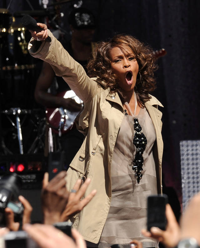 FILE - In this Sept. 1, 2009 file photo, Whitney Houston performs on 'Good Morning America' in Central Park in New York.  Whitney Houston, who reigned as pop music's queen until her majestic voice and regal image were ravaged by drug use, has died, Saturday, Feb. 11, 2012. She was 48. (AP Photo/Evan Agostini)  ORG XMIT: NY132