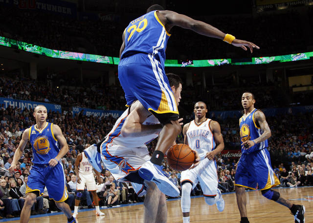 Golden State's Ekpe Udoh (20) lands on Oklahoma City's Nick Collison (4) as Golden State's Stephen Curry (30), left, and Monta Ellis (8) look on along with Oklahoma City's Russell Westbrook (0) during the NBA basketball game between the Oklahoma City Thunder and the Golden State Warriors at the Chesapeake Energy Arena in Oklahoma City, Friday, Feb. 17, 2012. Photo by Nate Billings, The Oklahoman