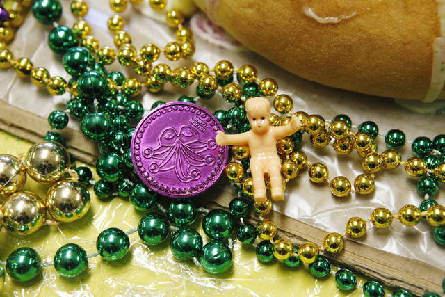 A tiny baby Jesus and assorted Mardi Gras items are packaged with a king cake baked as part of a fundraiser at Douglas Boulevard United Methodist Church, 208 S Douglas Blvd. in Midwest City. <strong>PAUL B. SOUTHERLAND - PAUL B. SOUTHERLAND</strong>