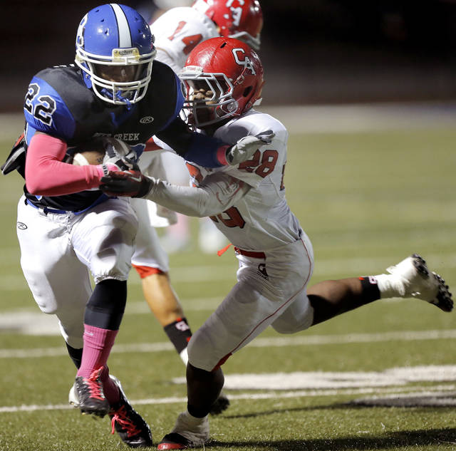 Deer Creek's Marcus Coleman tries to get by Carl Albert's Keshon Harris during the high school football game between Deer Creek and Carl Albert at Deer Creek High School, Friday, Sept. 21, 2012.  Photo by Sarah Phipps, The Oklahoman