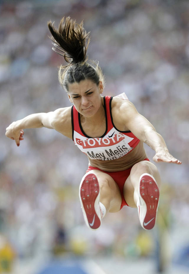 FILE - In this Aug. 23, 2009 file photo Turkey's Karin Mey Melis competes in the final of the Women's long jump during the World Athletics Championships in Berlin, Germany. The International Association of Athletics Federations says it withdrew Turkish long jumper Mey Melis from the London Olympics final after it was told of her earlier positive test for doping. IAAF spokesman Yannis Nikolaou told The Associated Press Tuesday, Sept. 18, 2012, that it got confirmation of her positive test from the European Championships after she advanced from the qualifying round in London. The IAAF has asked the Turkish athletics federation to conduct a disciplinary case. (AP Photo/Matt Dunham, File)
