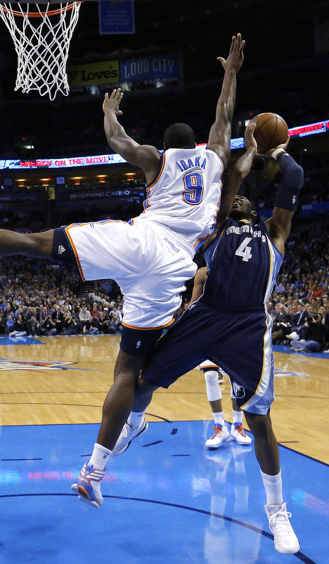 Oklahoma City's Serge Ibaka (9) defends against Memphis' Chris Johnson (4) during the NBA basketball game between the Oklahoma City Thunder and the Memphis Grizzlies at the Chesapeake Energy Arena in Oklahoma City,  Thursday, Jan. 31, 2013.Photo by Sarah Phipps, The Oklahoman