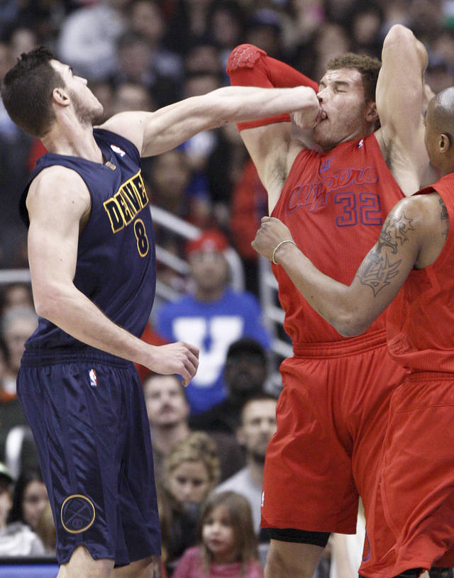 Los Angeles Clippers forward Blake Griffin (32) is fouled by Denver Nuggets' Danilo Gallinari (8) of Italy during the first half of their NBA basketball game, Tuesday, Dec. 25, 2012, in Los Angeles. (AP Photo/Jason Redmond)