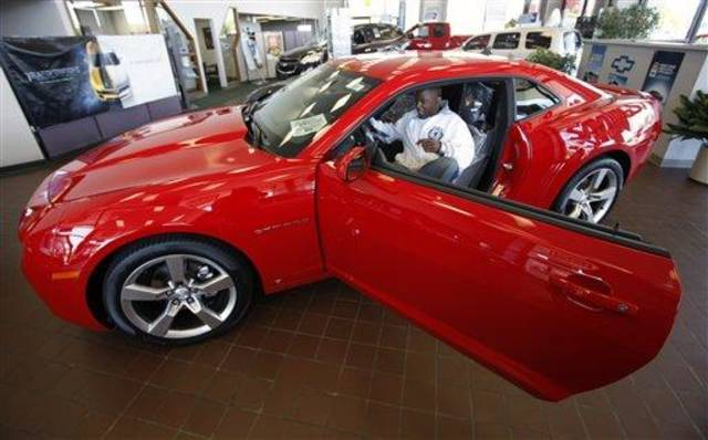 Jon Stanfield gets behind the wheel of a new 2010 Chevy Camaro RS inside the showroom at Glen Campbell Chevrolet in Williamsville, N.Y. Friday, May 15, 2009. GM says it will notify 1,100 U.S. dealers on Friday May 15, 2009 that their franchise agreements will not be renewed. This dealership would neither deny or confirm they had received a call from GM. (AP Photo/David Duprey)