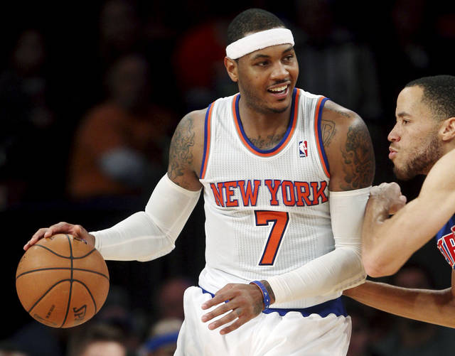 New York Knicks' Carmelo Anthony (7) is guarded by Detroit Pistons' Tayshaun Prince during the second half of an NBA basketball game in New York, Sunday, Nov. 25, 2012. The Knicks won 121-100. (AP Photo/Seth Wenig)