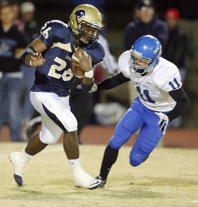 Heritage Hall's Barry Sanders (26) tries to get past Caden Locke (11) of Bridge Creek in the first quarter during the high school football playoff game between Bridge Creek and Heritage Hall at Heritage Hall School in Oklahoma City, Friday, Nov. 19, 2010. Photo by Nate Billings, The Oklahoman