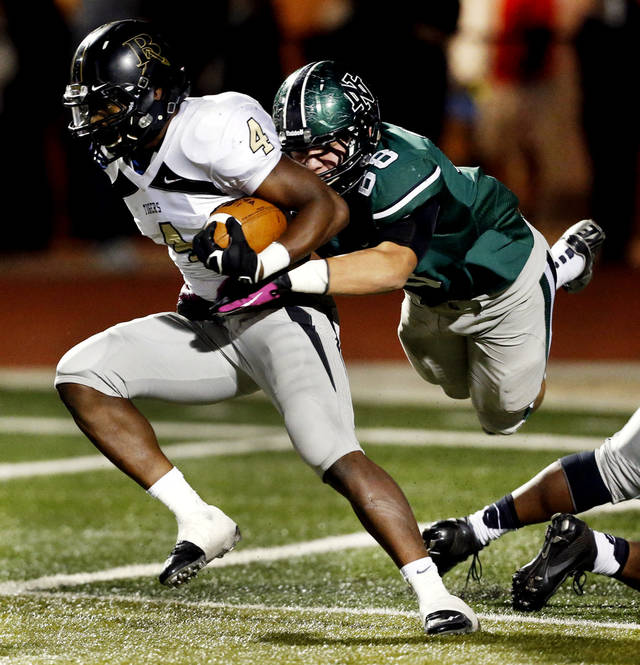 HIGH SCHOOL FOOTBALL PLAYOFFS: Norman North Timberwolf Evan Coles tackles Broken Arrow running back Devon Thomas as the Tigers  play Norman North in Class 6A football on Friday, Nov. 16, 2012 in Norman, Okla.  Photo by Steve Sisney, The Oklahoman