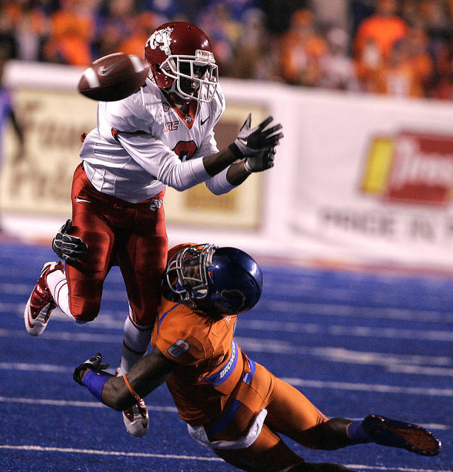 Fresno State's Jalen Saunders (6) tries to come up with a catch against the defense of Boise State's George Iloka (8) during the second half of an NCAA college football game on Friday, Nov. 19, 2010 in Boise, Idaho.  (AP Photo/Matt Cilley)