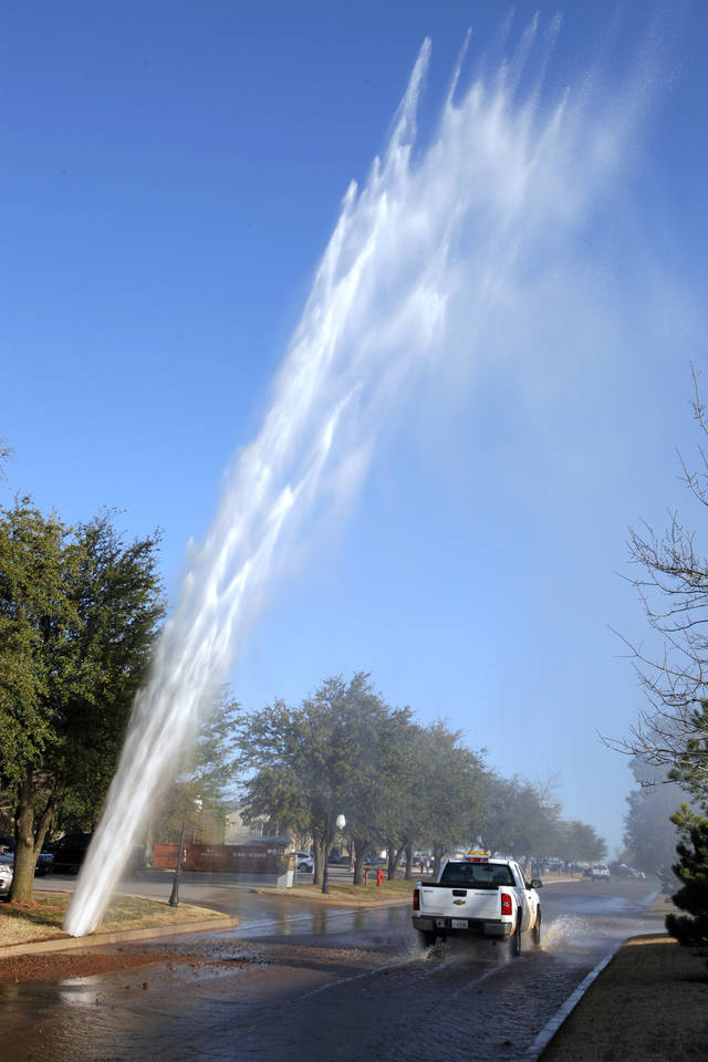 A water main break in the 9300 block of Cedar Lake Avenue just north of Britton Road and west of Kelley Avenue in Oklahoma City Tuesday, March 13, 2012. Photo by Paul B. Southerland, The Oklahoman