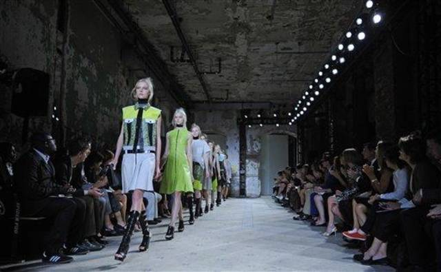 The Proenza Schouler Spring 2013 collection is modeled during Fashion Week in New York, Wednesday, Sept 12, 2012. (AP Photo/Stephen Chernin)