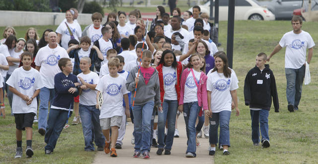 Right: Midwest City-Del City School District seventh-graders take a tour of the Rose State College campus in Midwest City.