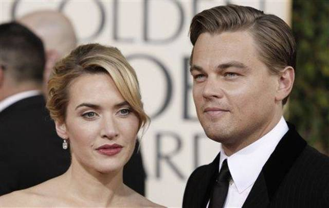 Kate Winslet, left, and Leonardo DiCaprio arrive at the 66th Annual Golden Globe Awards on Sunday, Jan. 11, 2009, in Beverly Hills, Calif. (AP Photo/Matt Sayles)