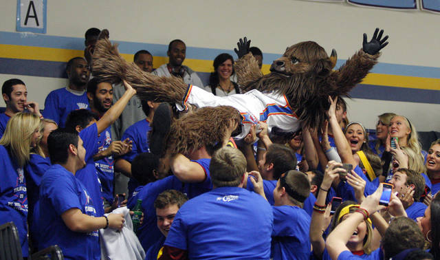 OKLAHOMA CITY THUNDER NBA BASKETBALL TEAM SCRIMMAGE: Rumble the Bison of the Oklahoma City Thunder rides on top of fans prior to the start of a scrimmage at Putnam City West High School in Oklahoma City, Friday, Dec. 16, 2011. Photo by Bryan Terry, The Oklahoman