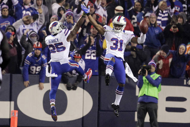 Buffalo Bills free safety Jairus Byrd (31) celebrates with teammate Da'Norris Searcy (25) after intercepting a pass during the second half of an NFL football game Thursday, Nov. 15, 2012 in Orchard Park, N.Y. The Bills won the game 19-14. (AP Photo/Bill Wippert)