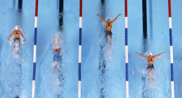Natalie Coughlin, from left, Elaine Breeden, Dana Vollmer and Kathleen Hersey compete in the women's 100-meter butterfly final at the U.S. Olympic swimming trials, Tuesday, June 26, 2012, in Omaha, Neb. Voollmer won the race. (AP Photo/Mark Humphrey)
