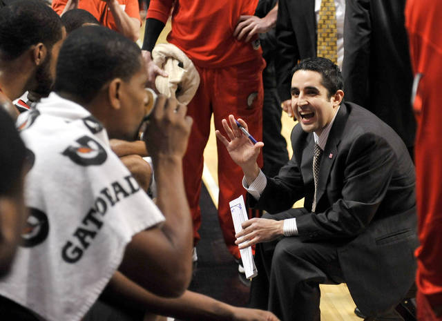 Portland Trail Blazers head coach Kaleb Canales talks to his team during a timeout in the first quarter of an NBA basketball game against the Chicago Bulls, Friday, March 16, 2012, in Chicago. (AP Photo/Brian Kersey) ORG XMIT: CXA104