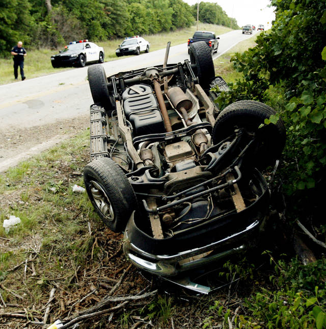 Police investigate a rollover accident on 156th street near Franklin Road in Norman, Okla. on Saturday, July 4, 2009.   One person was transported to the OU Trauma Center and another was placed in custody in the 6:00 pm accident.  Photo by Steve Sisney, The Oklahoman