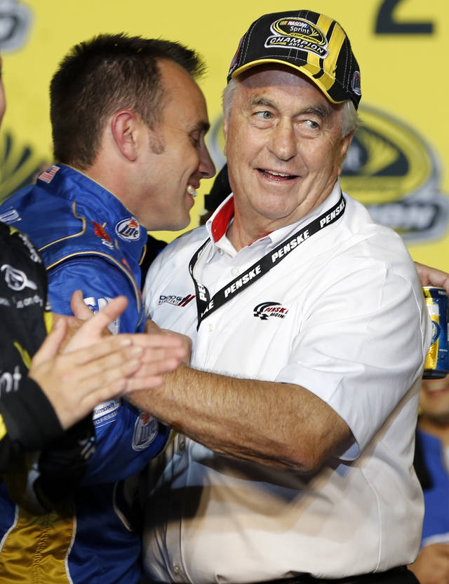 Crew chief Paul Wolfe, left, congratulates owner Roger Penske after Brad Keselowski won the NASCAR Sprint Cup Series championship following an auto race at Homestead-Miami Speedway, Sunday, Nov. 18, 2012, in Homestead, Fla. (AP Photo/Terry Renna)