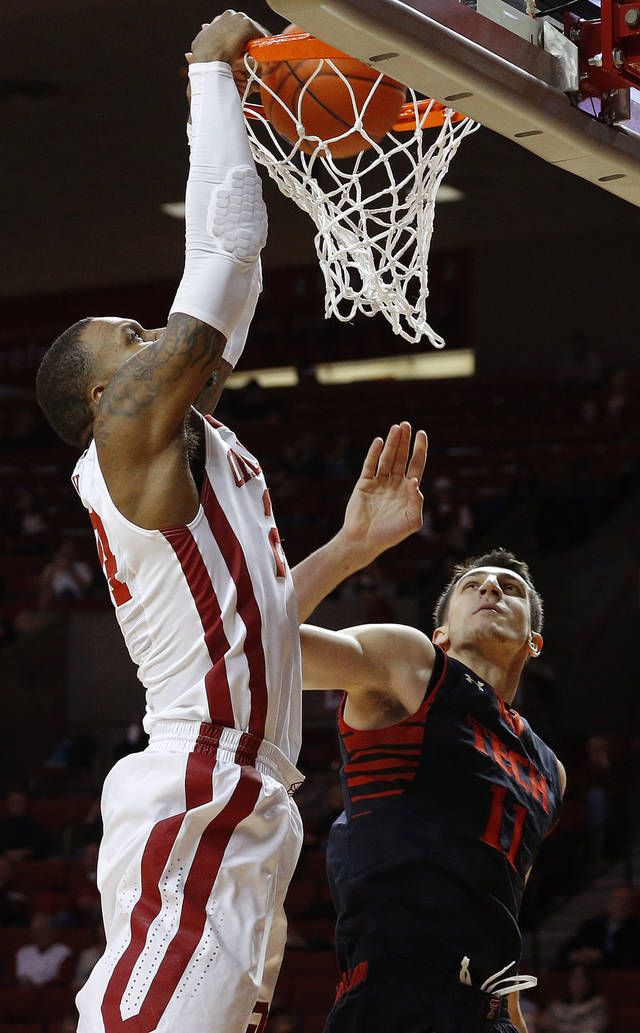 Oklahoma&#039;s Romero Osby (24) dunks beside Texas Tech&#039;s Dejan Kravic (11) during an NCAA college basketball game between the University of Oklahoma and Texas Tech University at Lloyd Noble Center in Norman, Okla., Wednesday, Jan. 16, 2013. Photo by Bryan Terry, The Oklahoman