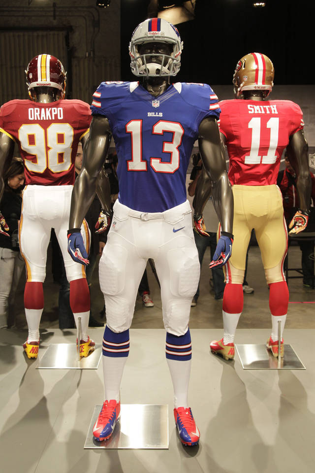 The new Buffalo Bills uniform is displayed on a mannequin in New York, Tuesday, April 3, 2012. NFL has unveiled its new sleek uniforms designed by Nike. While most of the new uniforms are not very different visually, they all are made with new technology that make them lighter, dryer and more comfortable. (AP Photo/Seth Wenig)