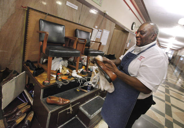 Cleo Fields, with Cleo's Professional Shine, working on shoes dropped off at his shoe shine booth on the ground floor of the Oklahoma County Courthouse in Oklahoma City Friday, March 16, 2912. Photo by Paul B. Southerland, The Oklahoman