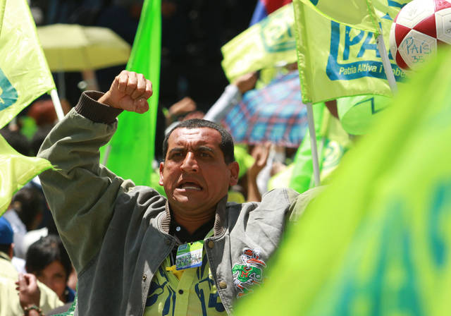 A supporters of Ecuador's President Rafael Correa cheers at an Alianza Pais convention rally where Correa announced his re-election bid for the upcoming February election and introduced his running mate Jorge Glas, former minister of Strategic Coordination, in Quito, Ecuador, Saturday, Nov. 10, 2012. (AP Photo/Martin Jaramillo)