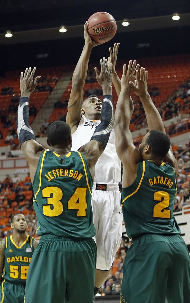 Oklahoma State 's Le'Bryan Nash (2) shoots over Baylor's Cory Jefferson (34) and Rico Gathers (2) during the college basketball game between the Oklahoma State University Cowboys (OSU) and the Baylor University Bears (BU) at Gallagher-Iba Arena on Wednesday, Feb. 5, 2013, in Stillwater, Okla. Photo by Chris Landsberger, The Oklahoman
