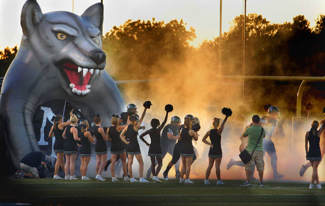 Cheerleaders cheer at the entry of the Timberwolves as Norman North plays Del City in high school football at Harve Collins Field on Thursday, Sept. 9, 2010, in Norman, Okla.  Photo by Steve Sisney, The Oklahoman