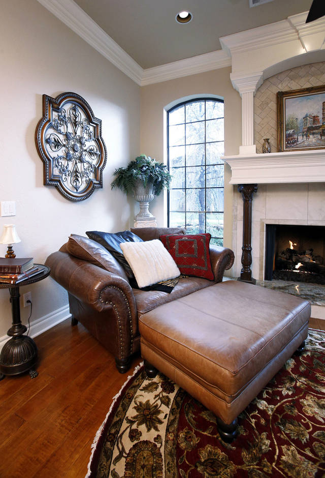 The master suite, complete with fireplace and sitting area, provides plenty of room for relaxing in the Dinnes home.