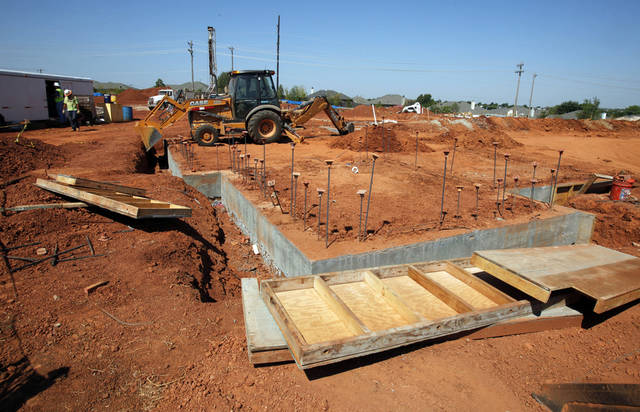 A construction crew works on the foundation for Norman Fire Station No. 9, being built on Alameda Street, just east of 24th Avenue SE.  PHOTO BY STEVE SISNEY, THE OKLAHOMAN