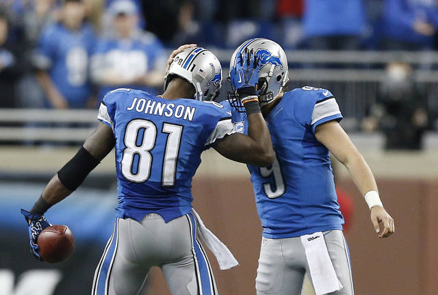 Detroit Lions wide receiver Calvin Johnson (81) is congratulated by quarterback Matthew Stafford in the fourth quarter of an NFL football game against the Atlanta Falcons after Johnson broke Jerry Rice's record for single-season receiving yards, in Detroit on Saturday, Dec. 22, 2012. (AP Photo/Rick Osentoski)