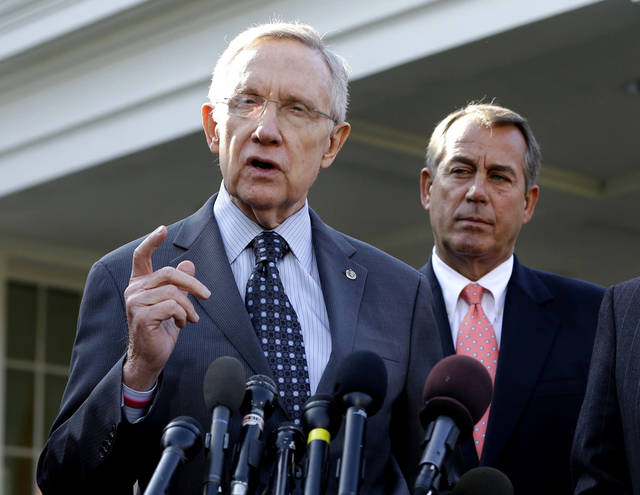 FILE - This Nov. 16, 2012 file photo shows Senate Majority Leader Harry Reid of Nev., left, with House Speaker John Boehner of Ohio looking on, speaking to reporters outside the White House in Washington following a meeting with President Barack Obama to discuss the economy and the deficit. President Barack Obama�s re-election has stiffened Democrats� spine against cutting popular benefit programs like Medicare and Social Security. Their new resolve could become as big a hurdle to reaching a deal for skirting economy-crippling tax increases and spending cuts in January as Republicans� resistance raising tax rates on the wealthy. (AP Photo/Jacquelyn Martin, File)