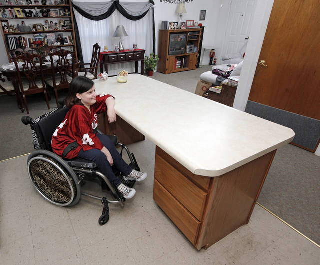 Sarah Skinner sits at the kitchen island designed so a wheelchair can pull up to it in her unit at Jack Mills' On Golden Pond neighborhood. The development on the northeast corner of NW 36 and Amelia, near NW 39 and Meridian Avenue, specializes in units that are affordable and accessible to the elderly and people with disabilities. PHOTO BY NATE BILLINGS, The Oklahoman