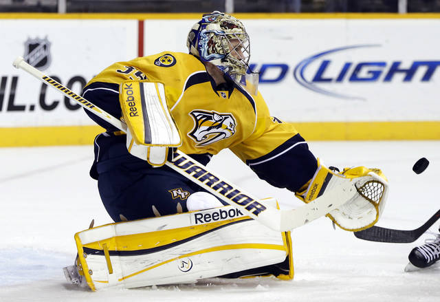 Nashville Predators goalie Pekka Rinne, of Finland, blocks a shot against the Los Angeles Kings in the first period of an NHL hockey game, Thursday, Feb. 7, 2013, in Nashville, Tenn. (AP Photo/Mark Humphrey)