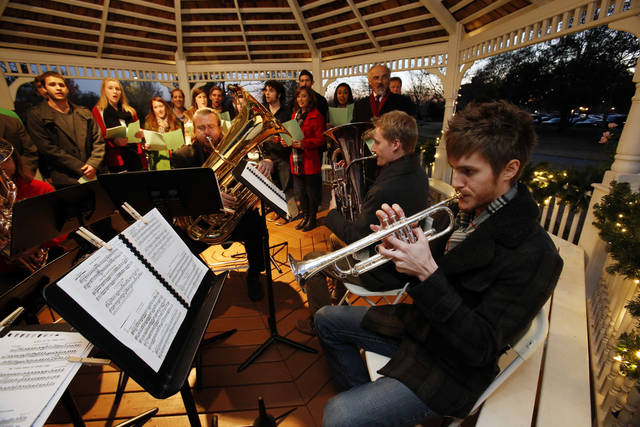 The Singing Sooners and the OU Wind Symphony Brass perform at the University of Oklahoma's holiday lights celebration. PHOTO BY STEVE SISNEY, THE OKLAHOMAN <strong>STEVE SISNEY</strong>