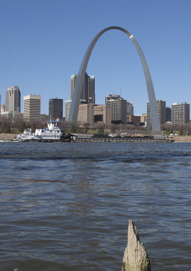 "A barge heads north on the Mississippi River past St. Louis on Monday, Nov. 12, 2012, as seen from East St. Louis, Ill. Missouri Gov. Jay Nixon and the barge industry are pressing the federal government to take steps to keep enough water flowing on the drought-ridden Missouri and Mississippi rivers to avert a potential ""economic disaster,"" given the Mississippi's importance as a commerce corridor. Winter typically is a low-water period on the two big rivers, but the situation is more dire this year with many points long the waterways at or near historic lows. (AP Photo/Jim Suhr)"