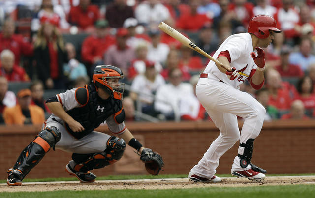 St. Louis Cardinals' Carlos Beltran (3) hits into a double play during the first inning of Game 3 of baseball's National League championship series against the San Francisco Giants Wednesday, Oct. 17, 2012, in St. Louis. Beltran left the game with a strained left knee. (AP Photo/David J. Phillip)