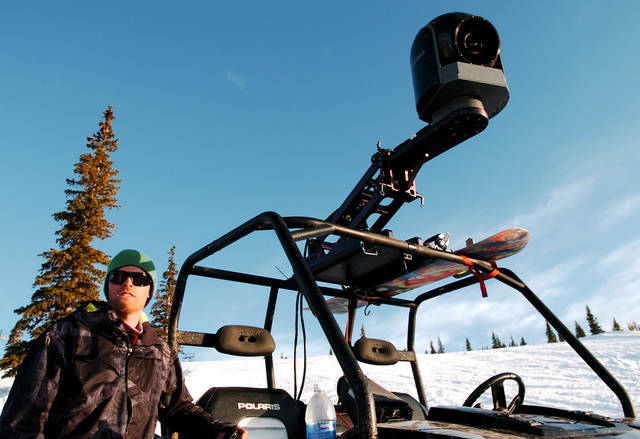 "In this May 8, 2011 photo, Chad Jackson, a producer for the snowboarding documentary ""The Art of Flight,"" stands next to the Cineflex camera system at Snowmass ski area in Colorado. The film will premiere on Sept. 7 in New York. (AP Photo/Thomas Peipert)"