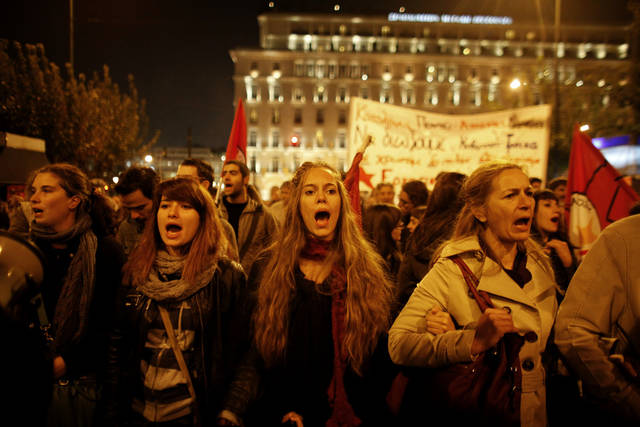 Protesters chant slogans in front of the Greek Parliament during an anti-austerity protest in Athens, Thursday, Nov. 3 2011. Greece's prime minister abandoned his explosive plan to put a European rescue deal to popular vote and opened emergency talks Thursday with his opponents, demanding their support in parliament to pass the hard-fought agreement into law. (AP Photo/Kostas Tsironis) ORG XMIT: ATH113