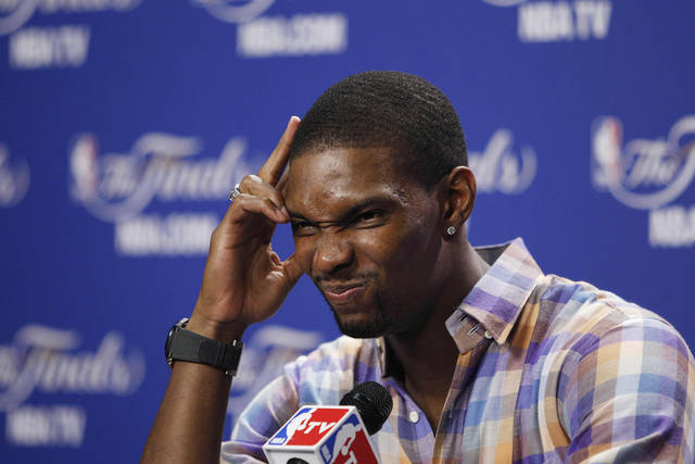 Miami Heat power forward Chris Bosh (1) reacts to a question during a news conference after Game 4 of the NBA finals basketball series against the Oklahoma City Thunder, Wednesday, June 20, 2012, in Miami. The Heat won 104-98. (AP Photo/Lynne Sladky)  ORG XMIT: NBA190