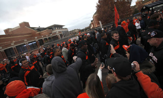 Fans greet players during the Spirit Walk before the Bedlam college football game between the Oklahoma State University Cowboys (OSU) and the University of Oklahoma Sooners (OU) at Boone Pickens Stadium in Stillwater, Okla., Saturday, Dec. 3, 2011. Photo by Sarah Phipps, The Oklahoman