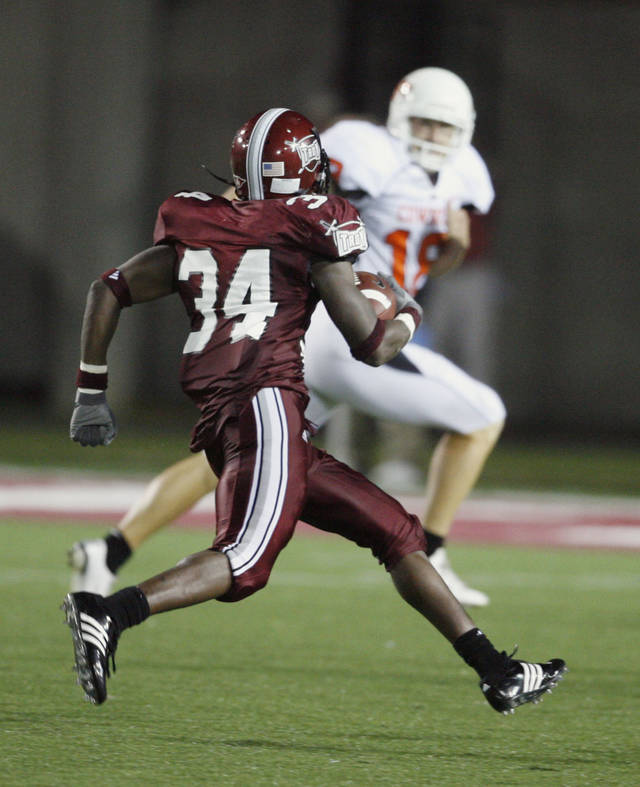 Troy's Leodis McKelvin runs back a punt for a touchdown. Cowboy punter Matt Fodge was the last hope for a tackle in first half action during the college football game between the Troy University Trojans and the Oklahoma State University Cowboys at Movie Gallery Veterans Stadium in Troy, Ala., Friday, September 14, 2007. BY STEVE SISNEY, THE OKLAHOMAN