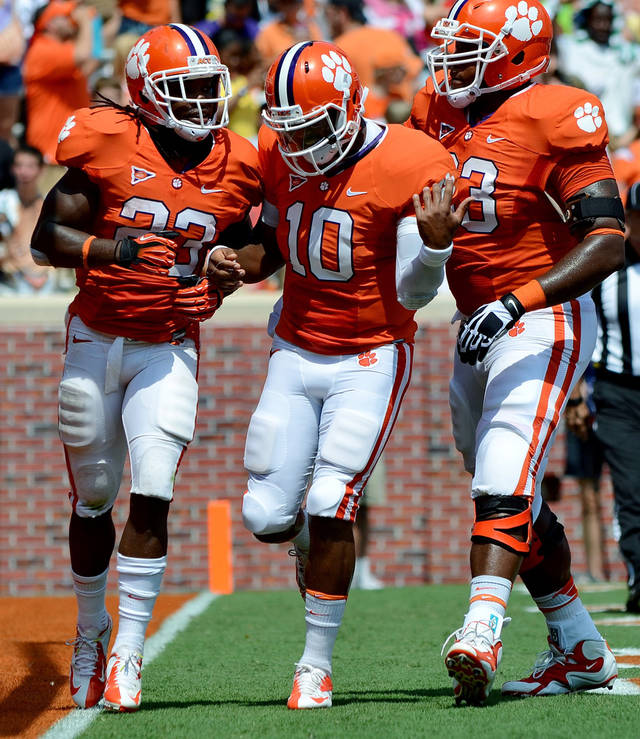 Clemson's Andre Ellington (23) celebrates a touchdown with teammates Tajh Boyd (10) and Daniel Rodriguez during the first half of an NCAA college football game against Ball State Saturday, Sept. 8, 2012 at Memorial Stadium in Clemson S.C. (AP Photo/ Richard Shiro)